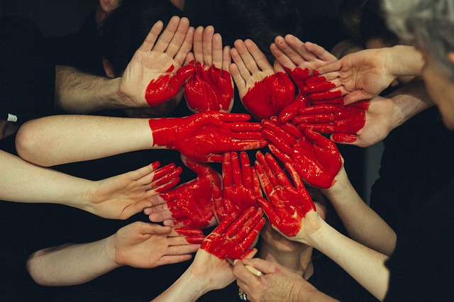 Photo of a heart painted onto joined hands in an article about love on the Church of Christ Truthseekers SCCOC website