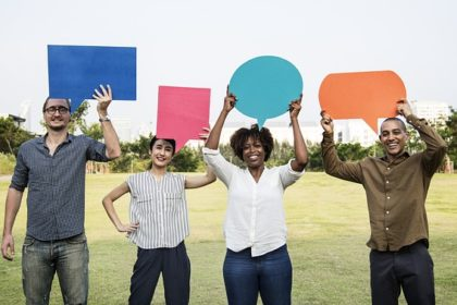 Photo of friends holding speech bubbles in an article on evangelism and sharing the gospel truth at the Church of Christ Santa Clara Truthseekers website