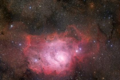 Nebula in the starry sky in an article about God dividing light from the dark.