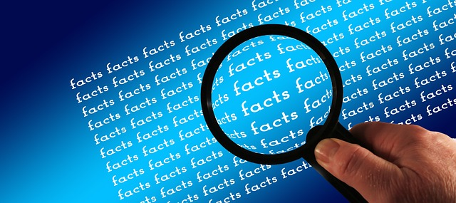 Photo of magnifying glass hovering over the word 'fact' in an article on the Church of Christ Santa Clara SSCOC Truthseekers