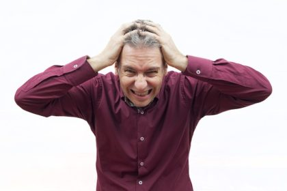 Photo of a man holding his head, appearing stressed in an article at the Church of Christ at Santa Clara SCCOC Truthseekers website.