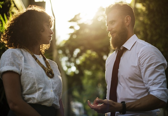 Photo of a man and woman talking outside in an article about sharing the gospel and personal evangelism on the SCCOC Truthseekers website by the Church of Christ Santa Clara.