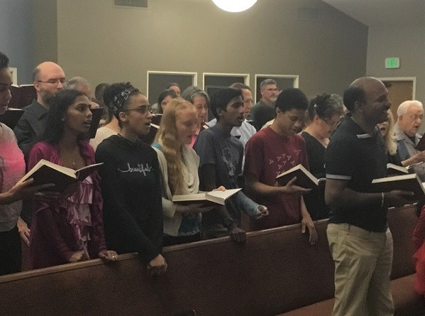 Photo of a group of people singing at the Church of Christ at Santa Clara