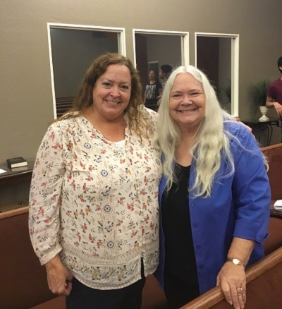 A photo of two ladies smiling at the Church of Christ Santa Clara SCCOC.