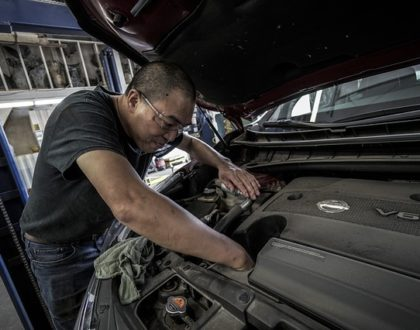 Photo of an auto mechanic under the hood of a car in an article on studying God's word on the Church of Christ Santa Clara SCCOC truthseekers.org website.